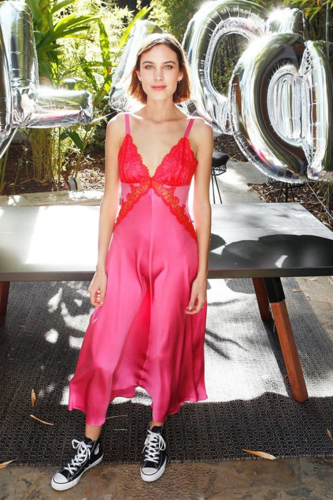 Alexa Chung wearing a hot pink dress