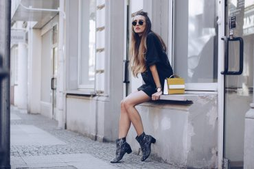Stylish woman wearing black chelsea boots