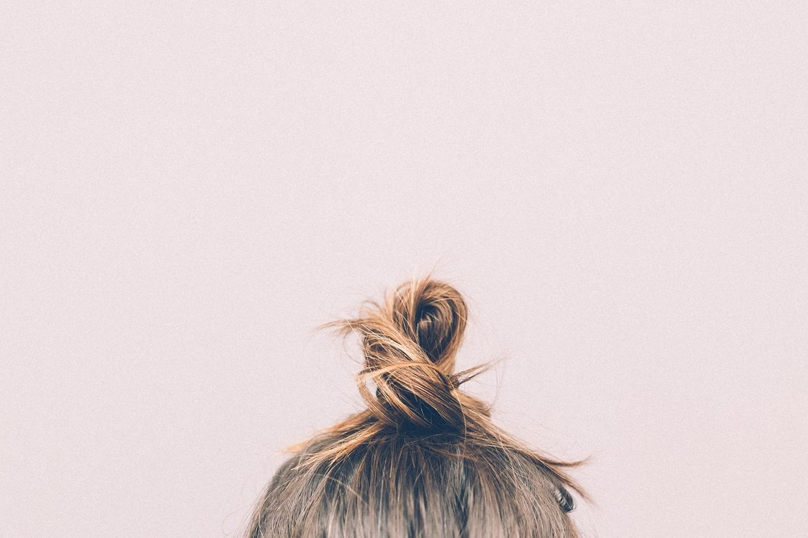 Woman with brunette hair in a bun