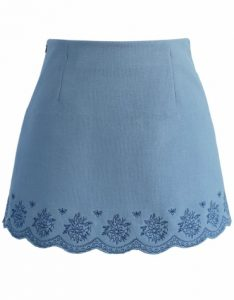 Embroidered blue mini skirt with scallop edge