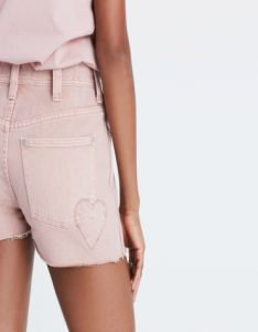 Blush pink denim shorts with heart detail on back pocket