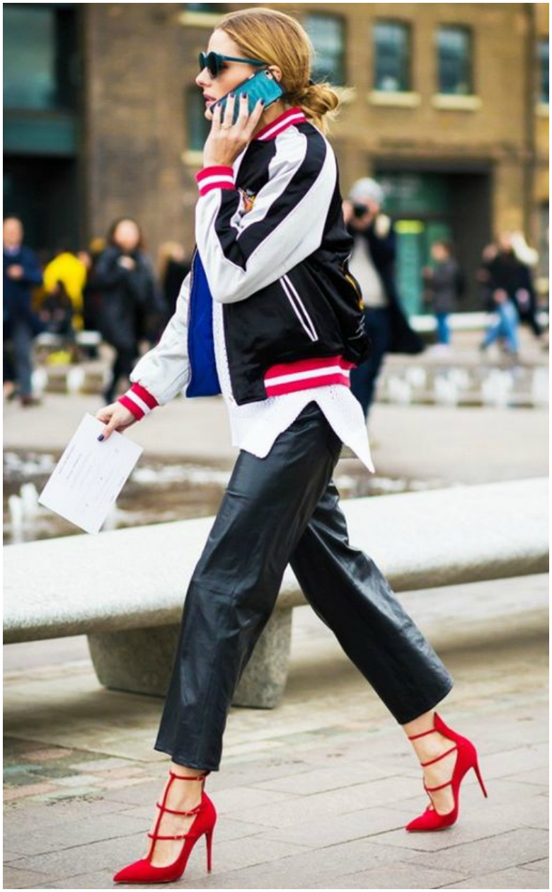 Olivia Palermo in sporty style bomber jacket, white shirt, leather trousers and heels