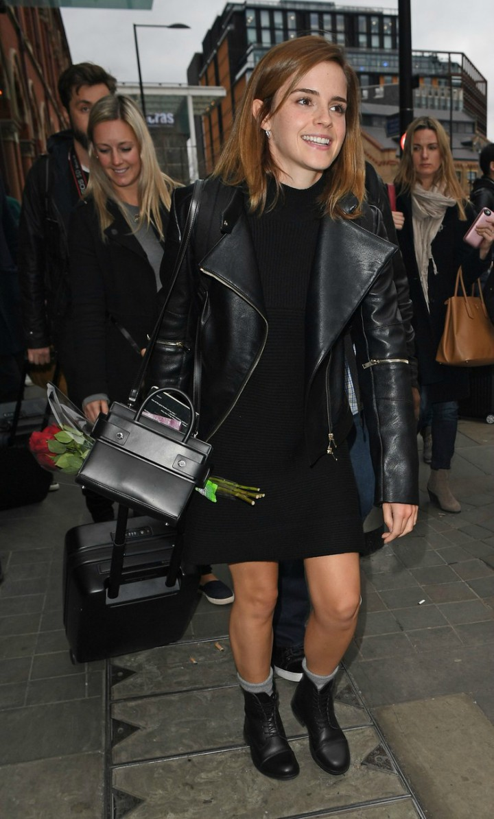 Emma Watson pairs a black box bag with black leather jacket and ribbed knit dress