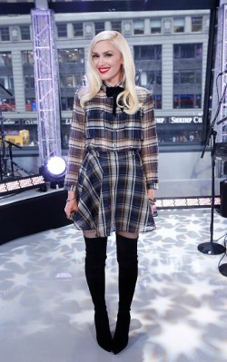Gwen Stefani wearing blue check dress with black over the knee boots and tights