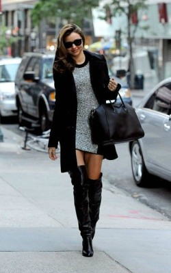 Miranda Kerr in grey and black tunic dress with over the knee black boots