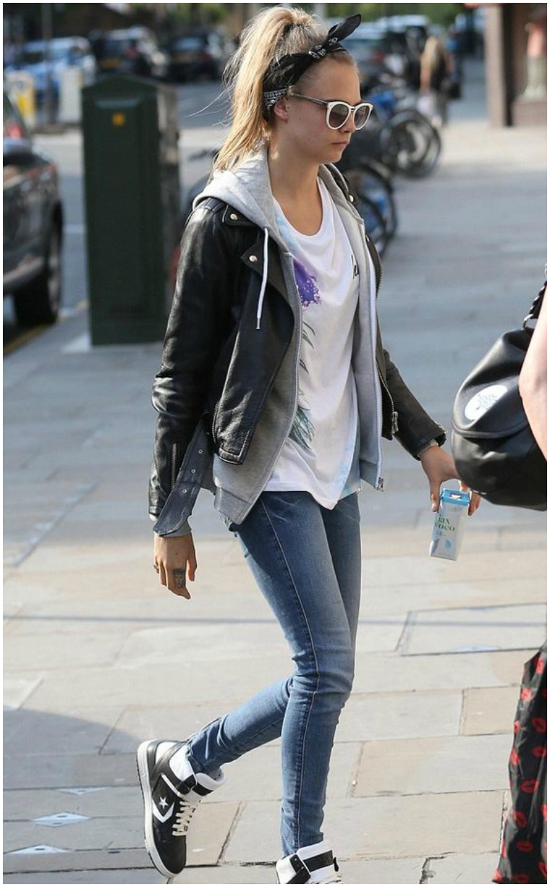 Cara Delavine black leather jacket grey hoodie white t-shirt blue jeans high-tops
