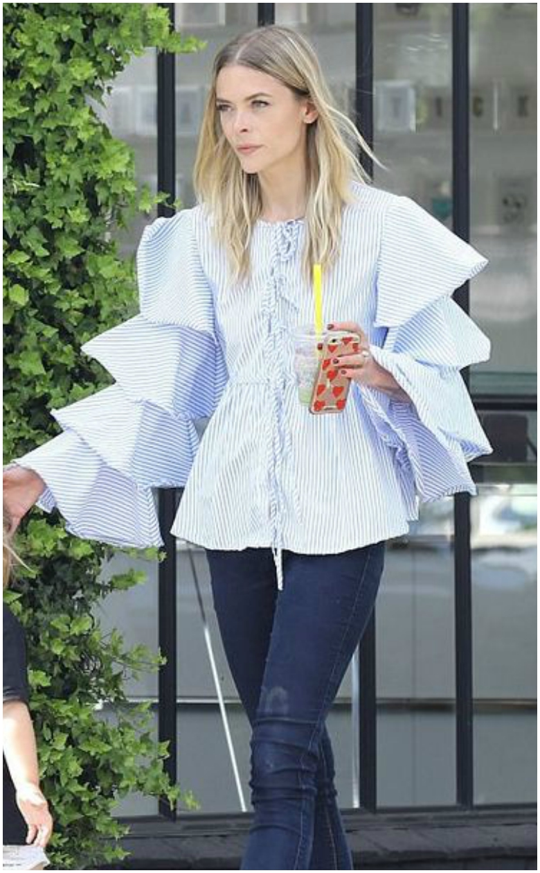 Jaimie King blue and white statement sleeve top and blue jeans