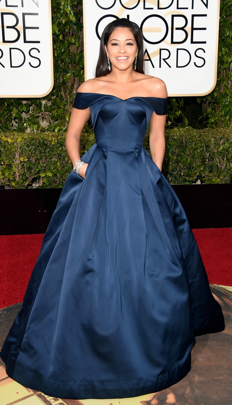 Gina Rodriguez in off the shoulder dark blue full length gown at the Golden Globes