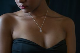 woman wearing black ball gown and necklace