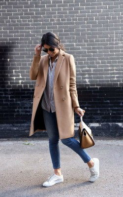 How to style a casual camel coat outfit - striped shirt and jeans with a camel coat
